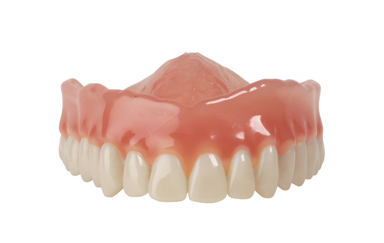 light reddish pink denture